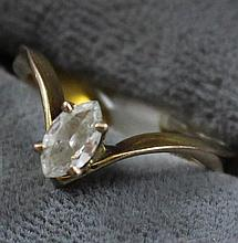 UNMARKED YELLOW GOLD APPROX .30 CT MARQUISE DIAMOND RING, SIZE 5 1/4, TESTS 10K, 2.0 GRAMS TOTAL, HAS CUT SHANK, REPLACEMENT VALUE $...