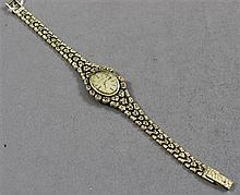 STAMPED 14K YELLOW GOLD ZODIAC LADIES WATCH WITH NUGGET STYLE BAND, 7