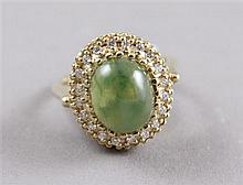 STAMPED 14K YELLOW GOLD JADE TYPE FASHION RING WITH DIAMONDS SURROUNDING, SIZE 6 1/4, 6.4 GRAMS TOTAL