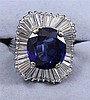 18K WHITE GOLD BALLERINA STYLE BLUE SAPPHIRE COCKTAIL RING WITH SURROUNDING BAGUETTE DIAMONDS, SIZE 8 1/2 REPLACEMENT VALUE $9,075.0...
