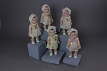 7 1/2'' COMPOSITION MADAME ALEXANDER DIONNE QUINTUPLETS IN ORIGINAL ORGANDY DRESSES