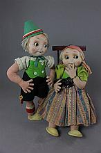 2 MOLDED FACE BOY AND GIRL DOLLS WITH FLIRTY, GOOGLY EYES