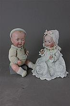 (2) UNMARKED SOLID DOME BISQUE HEAD CHARACTER BABIES