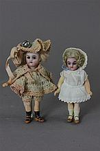 2 DOLLS INCLUDING 4