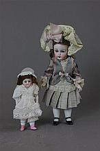5'' GERMAN 323 ALL BISQUE DOLL WITH REPRO FRIEND