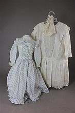 (2) ANTIQUE DOLL DRESSES