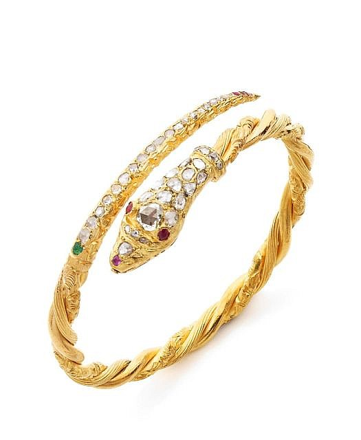 A DIAMOND, RUBY, EMERALD AND YELLOW GOLD SNAKE BRACELET