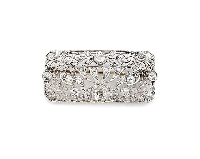 A DIAMOND, PLATINUM AND GOLD BROOCH, CIRCA 1925