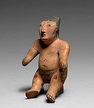 IMPORTANTE STATUETTE FÉMININE ASSISE Culture Nazca, Sud du Pérou Intermédiaire ancien 300-600 après J.-C. Céramique beige à engobe b...