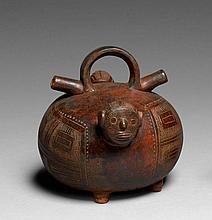 ALCARAZA À TÊTES D'HOMME ET D'OISEAU Culture Calima, Colombie 0-500 après J.-C. Céramique brun foncé fortement oxydée de noir à surf.
