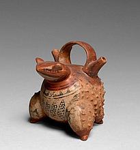 RÉCIPIENT EN FORME DE CRAPAUD Culture Calima, Colombie 0-500 après J.-C. Céramique bichrome brun orangé et rouge brique, peinture or...