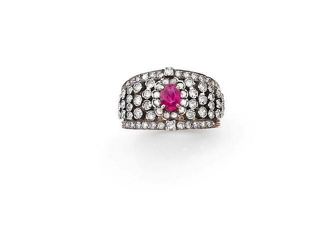 A RUBY, DIAMOND, SILVER AND YELLOW GOLD RING.