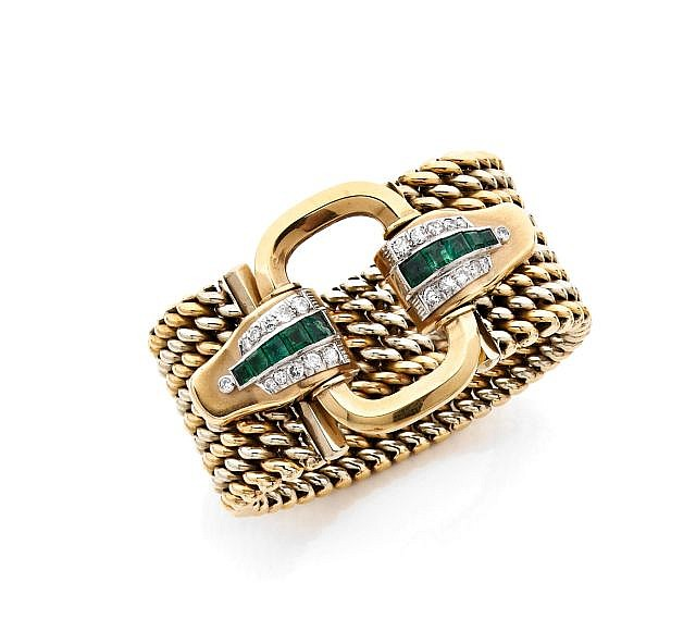 A DIAMOND, EMERALD AND GOLD BRACELET
