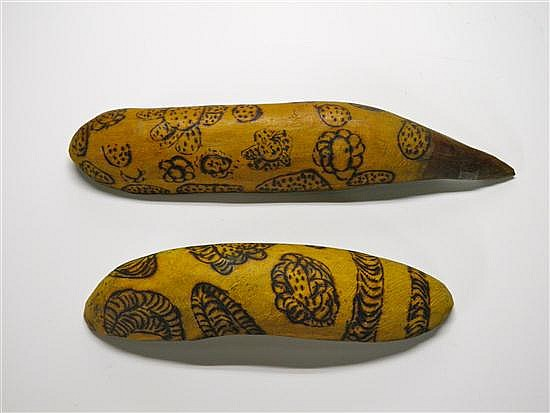 A PAIR OF VINTAGE ABORIGINAL COOLAMONS CARVED OUT OF DESERT HARDWOOD WITH POKER ART DECORATION OF FOOD GATHERING AREAS