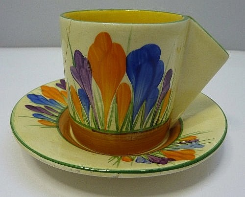 A Clarice Cliff Crocus pattern coffee can and