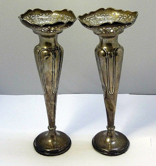 A pair of George V silver spill vases, makers