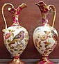 A pair of hand painted ewers