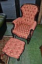 A Victorian style mahogany spoon back armchair and