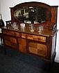 An early 20th century mahogany mirror back