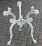 A cast iron tripod garden table base with lion