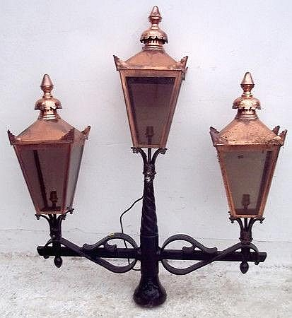 An early 20th century three light copper and cast