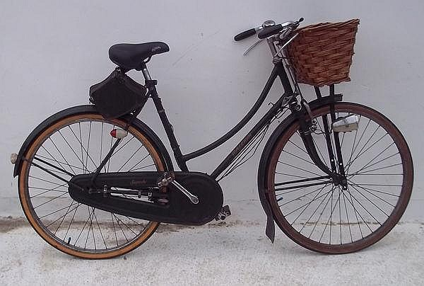 A Raleigh 1970s lady's bike with panier and