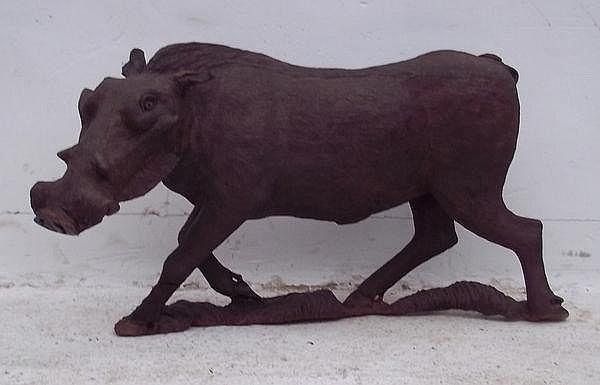A black forest carved warthog, 72 by 42cm. (a/f)