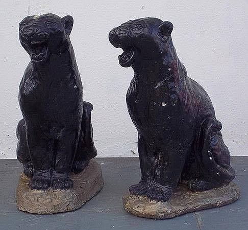 A pair of reconstituted stone panthers, modelled