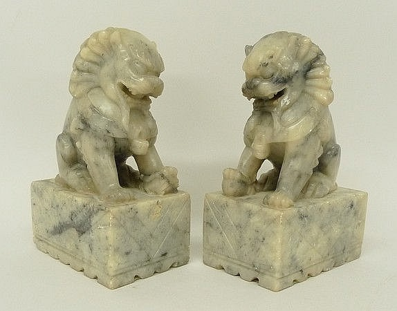 A pair of Chinese soapstone figures modelled as