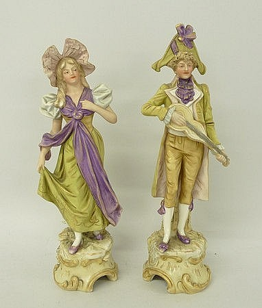 A pair of Royal Dux blush porcelain figures of a