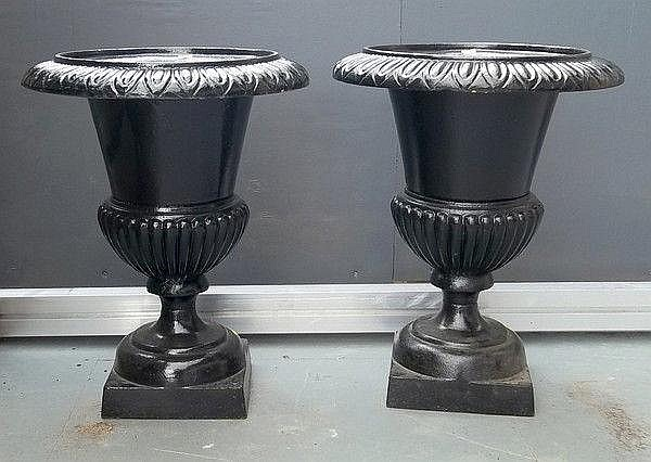 A pair of Victorian cast iron garden urns, painted