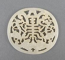A Chinese pale celadon jade disc of pierced, oval
