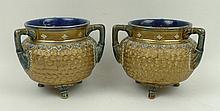 A pair of Royal Doulton stoneware vases, circa