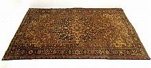 A Heriz carpet with a buff ground with large