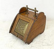 An Arts and Crafts oak and brass coal box, 33 by
