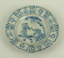 A Chinese blue and white dish painted with figures