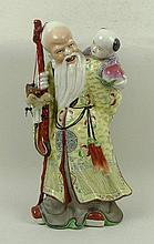 A Chinese porcelain figure of Shou Lao, 20th