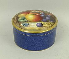 A Royal Worcester circular porcelain box and