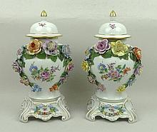 A pair of Dresden porcelain vases, covers and