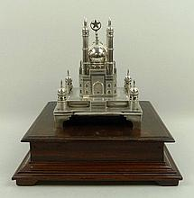 An Indian white metal model cast as the Taj Mahal,