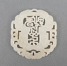 A Chinese white jade pendant carved with a pierced