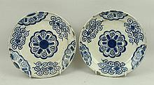 A pair of Continental tin glazed earthenware