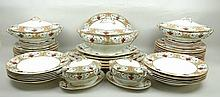 A Royal Doulton pottery dinner service decorated