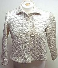 A lady's vintage quilted cropped jacket, in cream