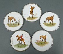 A set of five milk glass coasters with silver