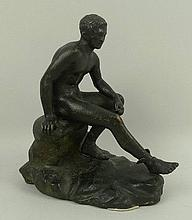 A bronze figure of Mercury resting, modelled on a