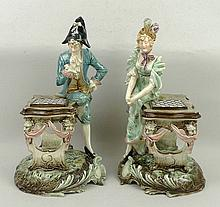 A pair of Continental pottery figures, late 19th