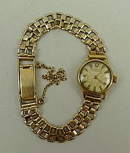 A lady's 9ct gold wristwatch by J.W. Benson,