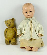 A straw filled teddy bear, 35cm high, and a