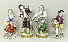 A pair of Sitzendorf porcelain figures modelled as
